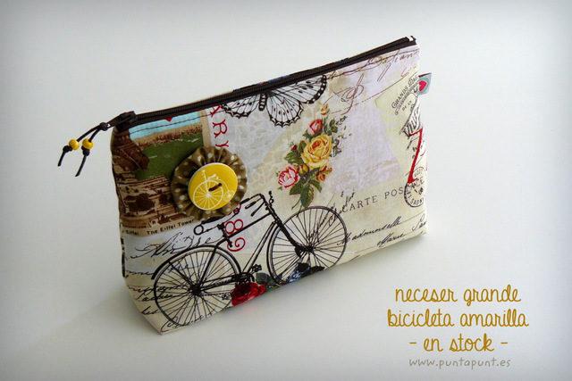 neceser-grande-en-stock-bicicleta-amarilla-punt-a-punt