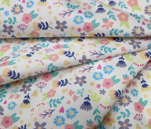 detalle textil florecillas punt a punt